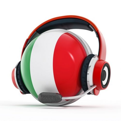 Headset on Italian flag covered sphere isolated on white. Simultaneous translation or call center concept.